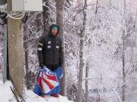 Andy Newell at the Alpine World Cup in Levi carrying the flag. [P] Liz Stephen