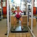 Squat test- we push against this bar that is impossible to move to measure the force we put on the scale below our feet [P] courtesy of Sadie Bjornsen