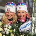 Jessie Diggins and Kikkan Randall celebrate team sprint silver in Milan. [P] Nordic Focus