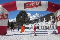 Caitlin standing under the Rivella blimp on the Engadin race course [P] Holly Brooks