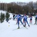 J2 boys with Ben Hegman (NE, Mansfield Nordic) leading a pack up the hill [P] Gunther Kern