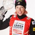 Kikkan Randall shows off her FIS Sprint World Cup crystal globe. [P] Nordic Focus