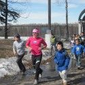 Holly Brooks running with the kids at ARISE. [P] courtesy of Holly Brooks