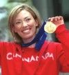 Beckie Scott with her Olympic gold medal [P] COC