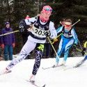 Cendrine Browne (bib 203) skis ahead of Sophie Carrier-Laforte (bib 209) as another competitor takes a spill. [P] John Sims