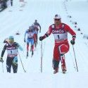 Northug bests Poltoranin (l) for the win.  [P] Nordic Focus