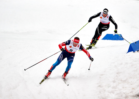 Vylegzhanin attacks with Cologna just behind [P] Nordic Focus