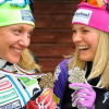 Caitlin Gregg and Jessie Diggins smile at their World Championships medals. [P]USSA
