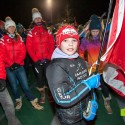 A young racer carries the flag for the Canadian squad at the Canmore Biathlon opening ceremonies [P] Pam Doyle