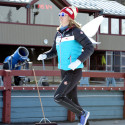 Cross country ski team member Dahria Beatty runs with wings as she help out the kids relay race [P] Pam Doyle